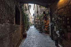 Orvieto, Umbria, Italy, narrow street with small shops Royalty Free Stock Photo
