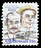 Orville and Wilbur Wright, And Flyer A, Wright Brothers Issue serie, circa 1978. MOSCOW, RUSSIA - MARCH 30, 2019: A stamp printed in United States shows Orville royalty free stock photo