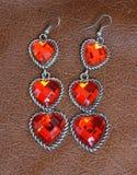 Oryginalni sercowaci kolczyki z trzy sercami i Ru z rzędu Obraz Stock