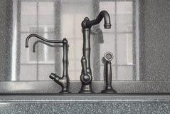 Oryginalny kuchenny melanżer przeciw tłu kamienny Apr Zdjęcie Royalty Free