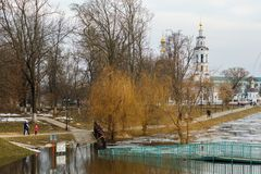 ORYOL, RUSSIA - APRIL 06, 2018: Flooded bridge over the river Ok. ORYOL, RUSSIA - APRIL 06, 2018: Flooded bridge over the river orlik leading to the stela stock photography