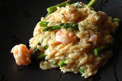 Orzo Pasta with seafood. Orzo pasta with shrimp and asparagus Royalty Free Stock Image