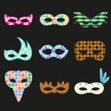 Os ícones coloridos do projeto das máscaras do teste padrão de rio do carnaval ajustaram eps10 Imagens de Stock Royalty Free