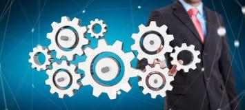 Os ícones coloridos tocantes da engrenagem do homem de negócios com seu dedo 3D arrancam Foto de Stock Royalty Free