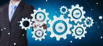 Os ícones coloridos tocantes da engrenagem do homem de negócios com seu dedo 3D arrancam Fotografia de Stock Royalty Free