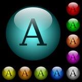 Os ícones da fonte de caráter na cor iluminaram os botões de vidro Fotografia de Stock