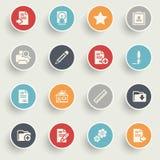 Os ícones de original com cor abotoam-se no fundo cinzento Foto de Stock
