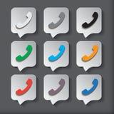 Os ícones do telefone ajustaram-se na bolha ou no botão do discurso Fotos de Stock