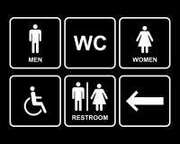 Os ícones masculinos e fêmeas do símbolo do toalete ajustaram-se com homens, mulheres, seta Fotografia de Stock