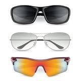 Os óculos de sol do homem ajustados Imagens de Stock
