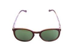 Os óculos de sol vermelhos das mulheres Fotografia de Stock