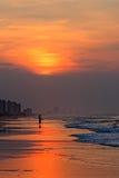 Силуэт рыболова восхода солнца Стоковые Изображения RF