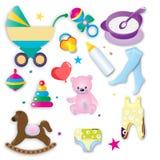 Os acessórios e a roupa do bebê Fotos de Stock