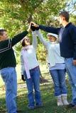 Os amigos juntam-se às mãos junto Foto de Stock