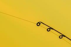Os anéis da vara de pesca fecham-se acima com fundo isolado Imagem de Stock