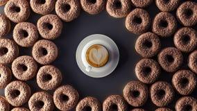 Os anéis de espuma do chocolate com a xícara de café no fundo preto 3d rendem ilustração royalty free