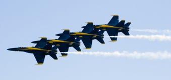 Os anjos azuis voam na formação fotografia de stock royalty free