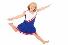 Os anos de idade 7 adoráveis no uniforme do líder da claque Fotos de Stock Royalty Free