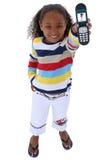 Os anos de idade seis bonitos com o telemóvel sobre o branco foto de stock royalty free