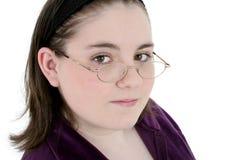 Os anos de idade treze bonitos com Close-Up dos vidros Foto de Stock Royalty Free