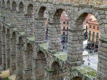 Os arcos de pedra de Roman Aqueduct de Segovia, Espanha Fotografia de Stock Royalty Free