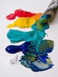Os artistas pintam e escovam Fotos de Stock