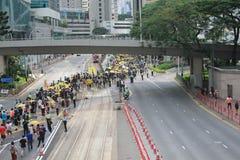 Os ativistas 2015 de Hong Kong marcham antes do voto no pacote eleitoral Imagens de Stock