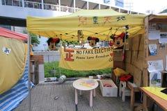 Os ativistas 2015 de Hong Kong marcham antes do voto no pacote eleitoral Foto de Stock