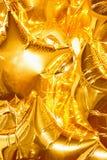 Os balões dourados das estrelas brilham e brilham Imagem de Stock Royalty Free