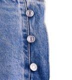 Os botões do diesel em calças de brim Foto de Stock