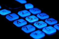 Os botões do telefone iluminam-se acima no macro da noite Fotografia de Stock