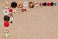 Os botões estão na lona bege Imagem de Stock Royalty Free