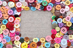 Os botões moldam com botões coloridos Fotografia de Stock