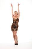 Os braços louros 'sexy' da menina levantaram no vestido curto Imagens de Stock Royalty Free