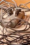 Os cabos de potência empoeirados tangled o mess Fotografia de Stock Royalty Free