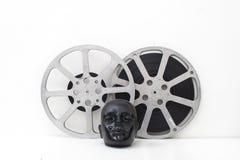 Os carretéis de filme de filmes velhos e do manequim preto dirigem Imagem de Stock Royalty Free