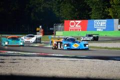 Os carros de competência do grupo C na ação no Ascari chicane Imagens de Stock Royalty Free