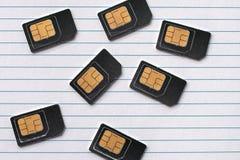 Os cartões de SIM são papel alinhado com Imagem de Stock