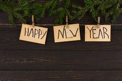 Os cartões, o ornamento e a festão do ano novo feliz moldam o fundo Imagens de Stock Royalty Free