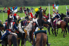 Os cavaleiros do cavalo em Borodino lutam o reenactment histórico em Rússia Foto de Stock Royalty Free