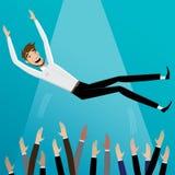 Os colegas lanç acima do homem de negócios Fotografia de Stock Royalty Free