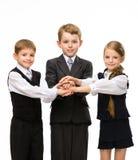 Os colegas pequenos uniram as mãos Fotos de Stock Royalty Free