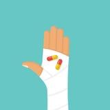 Os comprimidos encerram na palma paciente do ` s Fotos de Stock Royalty Free