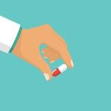 Os comprimidos encerram na palma paciente do ` s Imagem de Stock