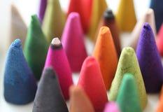 Os cones do incenso são coloridos Fotos de Stock Royalty Free