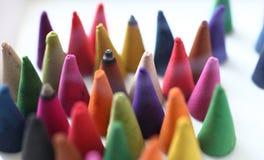 Os cones do incenso são coloridos Foto de Stock Royalty Free