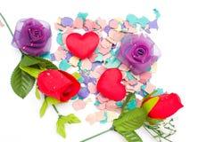 Os confetes e aumentaram Fotos de Stock Royalty Free