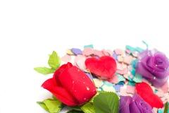 Os confetes e aumentaram Fotografia de Stock Royalty Free