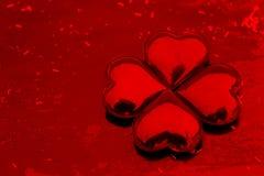 Os corações apresentaram sob a forma de uma flor imagem de stock