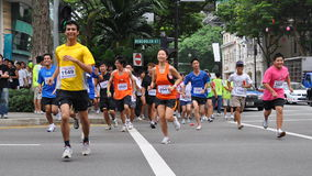 Os corredores em criam a ação agora! (POSSA) funcionado Foto de Stock Royalty Free